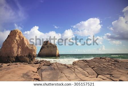 Beach, rocks and sea - stock photo