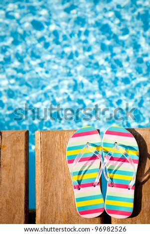 Beach`s flip flops on wood. Concept image of summer holidays - stock photo