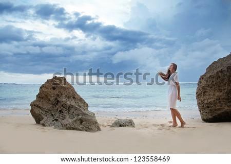Beach, sad beautiful woman - stock photo