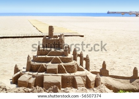 Beach sand castle summer vacation street art blue sea background - stock photo