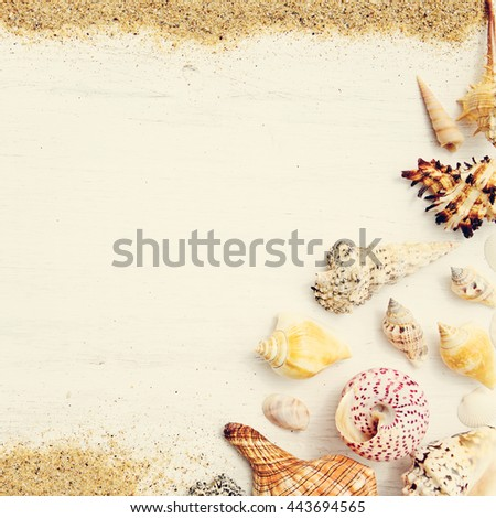 Beach sand, sea shells and starfish on a white wooden background. Photo in vintage style - stock photo