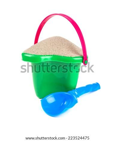 beach sand, shovel and bucket - stock photo