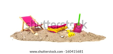 Beach sand with shells chair, toys and towels