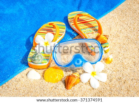 Beach sandals on the sandy coast - stock photo