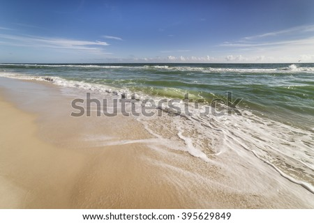Beach scenic at Gulf Islands National Seashore in Pensacola, Florida showing incoming surf, waves, clean sandy beach
