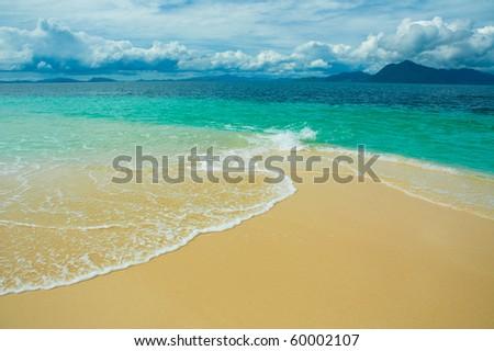 beach, sea and deep blue sky - stock photo