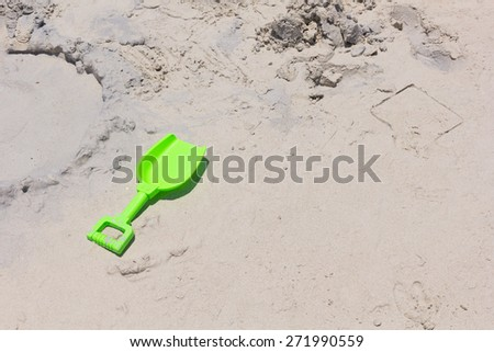 beach shovel stuck in the sand. - stock photo