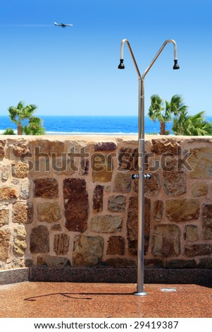 Beach shower near the main beach of resort - stock photo