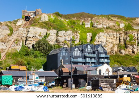 Beach side buildings with Hastings East Cliff Funicular Railway above. East Sussex England UK Europe