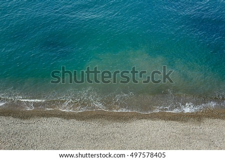 Beach stuff placed near sea. tropical turquoise blue sea. View from above.