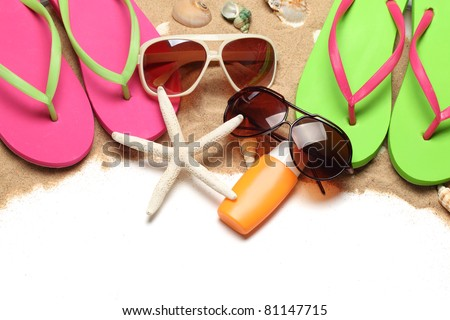 Beach stuff with sands on white background - stock photo