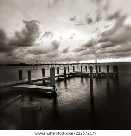 beach sunset in black and white - stock photo
