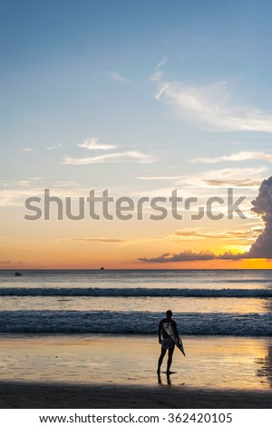 Beach sunset with people relax in twilight and color of sunset