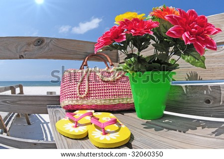 Beach supplies on boardwalk at seashore - stock photo
