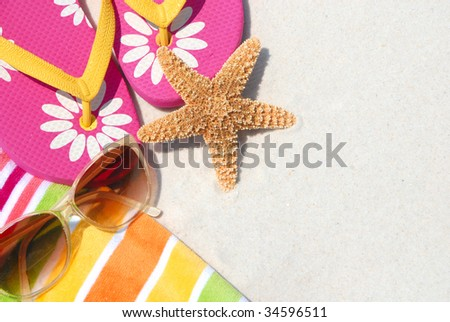 beach supplies on sand for fun summer holiday - stock photo