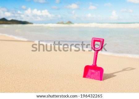 Beach toy in the sand. Summer fun. - stock photo
