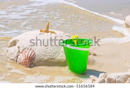 beach toys and shell at seashore - stock photo