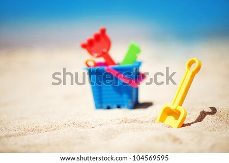 beach toys in the sand - stock photo