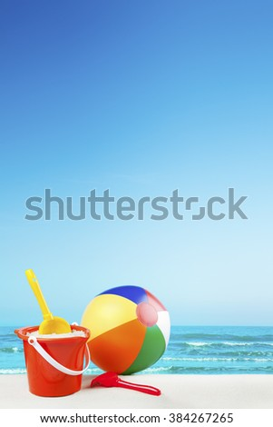 Beach toys on a beautiful white sand beach in summer. - stock photo
