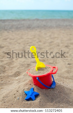 beach toys on sand - stock photo