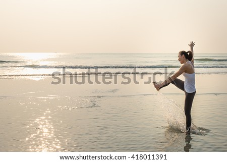 beach travel woman relaxing and playing on sea beach with happiness emotion