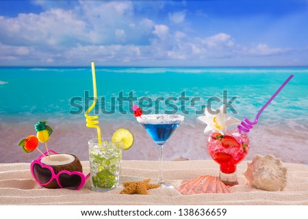 beach tropical cocktails on white sand mojito blue hawaii on white sand - stock photo