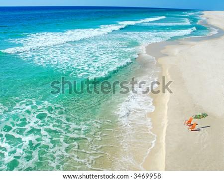 Beach umbrella and chairs - stock photo
