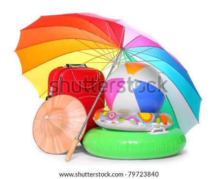 Beach umbrella and necessary articles for happy holidays in tropical destination. - stock photo