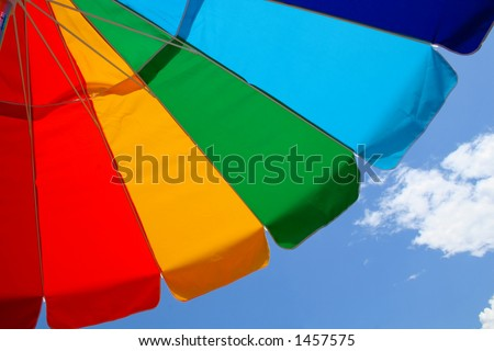 Beach Umbrella and Sky - stock photo