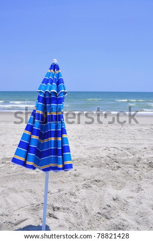 Beach umbrella at the sea shore - stock photo