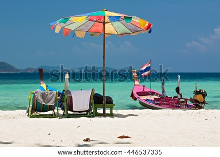 Beach umbrella in Komodo beach in Coral island, Thailand