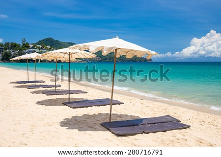 beach umbrella on beach with blue sky, phuket thailand - stock photo