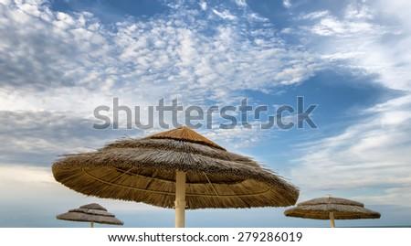 beach umbrella with nice sky - stock photo