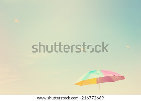Beach Umbrella with seagulls. Instagram effect - stock photo