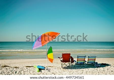 Beach Umbrellas and Chairs on Anna Maria Island, Florida - stock photo
