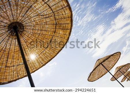 Beach umbrellas diagonally composed. - stock photo