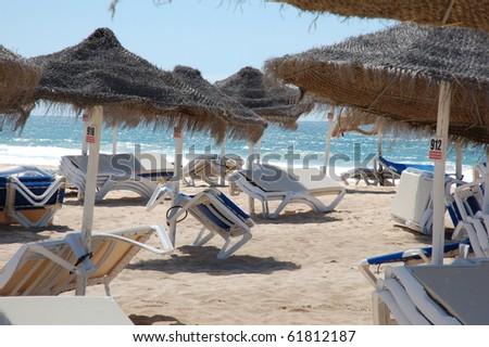 beach umbrellas in the blue sky - summer time - stock photo