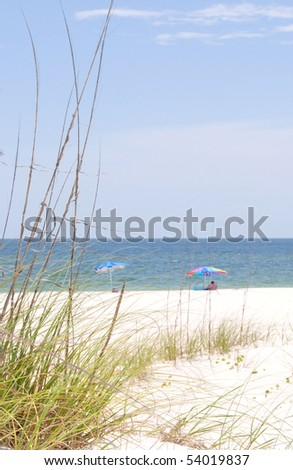 Beach umbrellas on beautiful seashore - stock photo