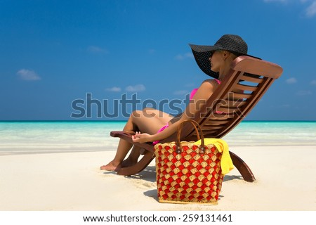Beach vacation. Hot beautiful woman enjoying looking view of beach - stock photo