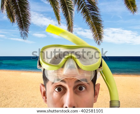 Beach vacation surprised man wearing a snorkel scuba mask making a goofy face. Closeup portrait of man on her travel holidays - stock photo