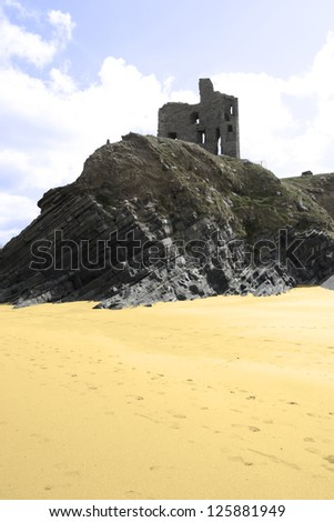 beach view of an old castle ruins in Ballybunion county Kerry Ireland - stock photo