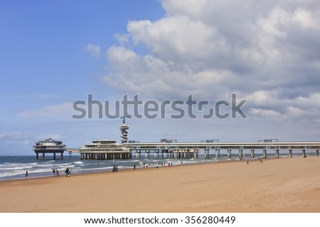 Beach view on the famous Pier at Scheveningen, The Hague, Holland - stock photo
