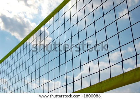 beach volley ball net in front of sky with clouds - stock photo