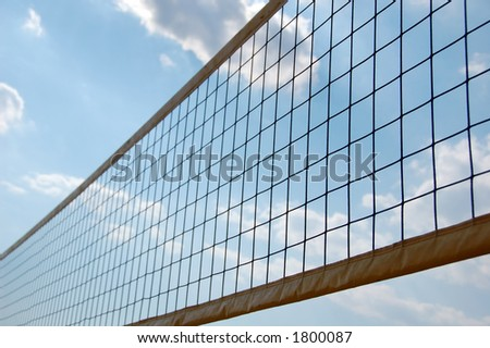 beach volley ball net in front of sky with clouds