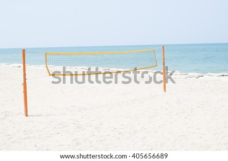 Beach Volley ball net on empty beach in summer day - stock photo