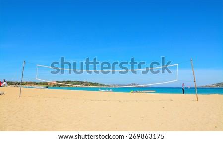 beach volley net and surfboards in Porto Pollo beach, Sardinia - stock photo