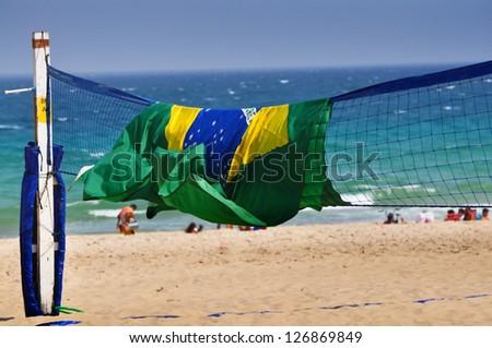 Beach volleyball field with Brazil flag at the Copacabana beach, Rio de Janeiro - stock photo