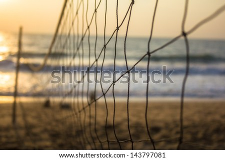 Beach volleyball in morning - stock photo