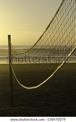 Beach volleyball net at sunset along Pacific coast of Oregon