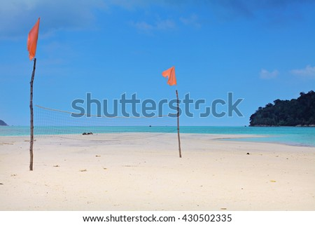 Beach volleyball net has been fixed for a beach game beside beautiful tropical island beach - Koh Adang, Satun Thailand - stock photo